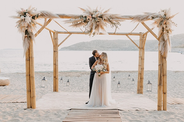 Boho chic beach wedding in Athens with pampas grass and pastel hues │ Nayia & Costas