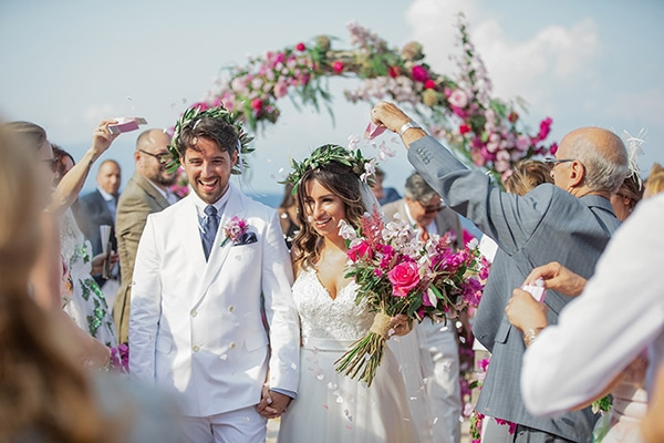 Romantic summer wedding in Kefalonia with bougainvillea