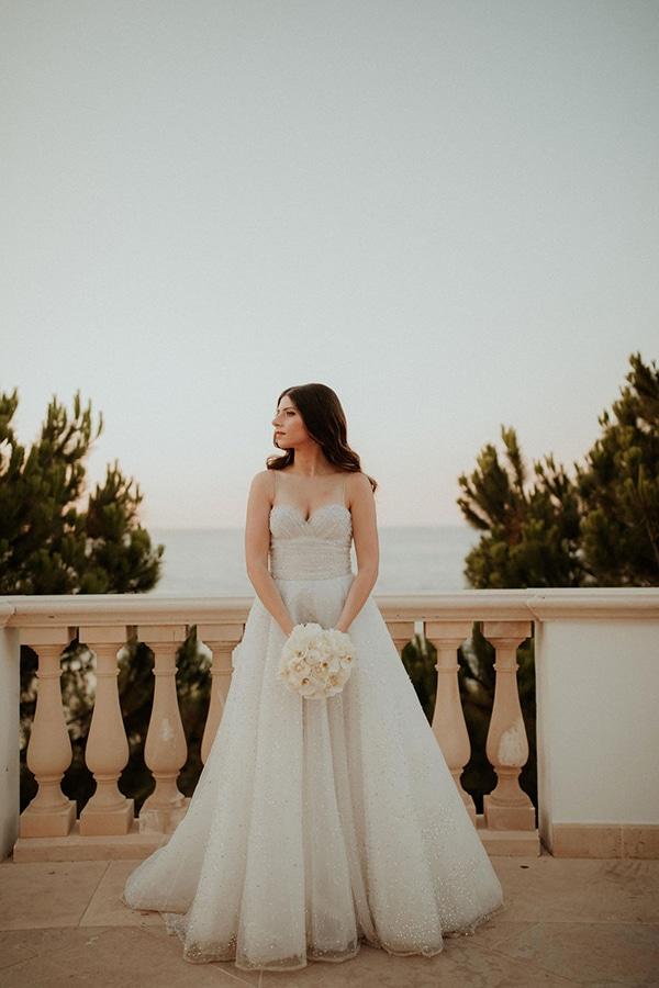 ultimate-romantic-wedding-anassa-hotel-lush-blooms-dusty-blue-tones_11